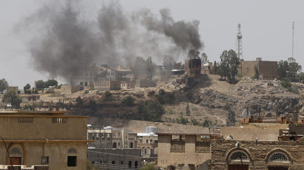 Smoke rises from the burning headquarters of the Yemeni state television building, which is under attack from Shi'ite Houthi militants, in Sanaa.