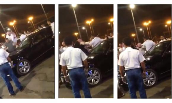 These still images taken from a videoclip posted on YouTube shows a Haia man jumping onto the back of British man Peter Howarth Lees, being slapped by Lees' wife Abeer, and being restrained by mall security and bystanders.