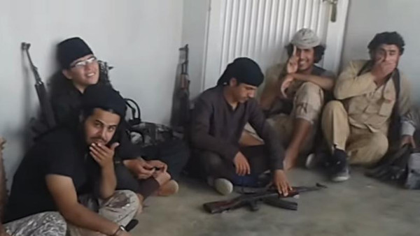 A group of ISIS militants take a break in an undisclosed location in Syria.
