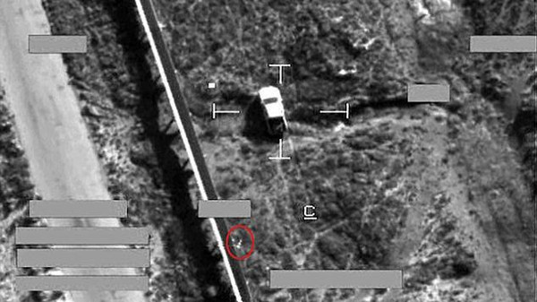 This is the moment a brimstone missile from an RAF jet (circled) fell on an armed pick-up truck in Iraq.