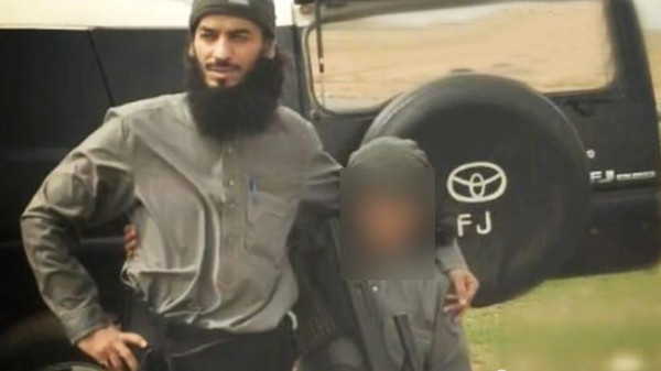 """ISIS supporters circulated pictures of the """"Cub of Baghdadi,"""" who they say is the youngest ISIS """"martyr"""" together with his father."""