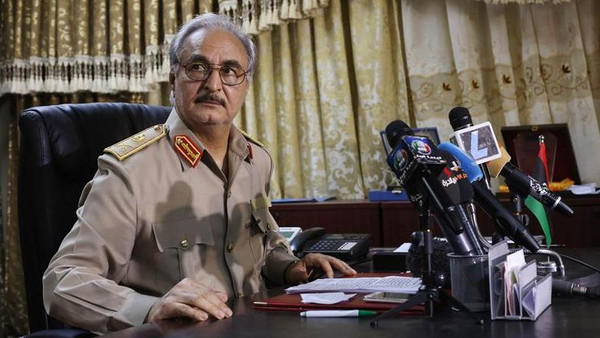 General Khalifa Haftar attends a news conference at Benina air base in Benghazi May 24.