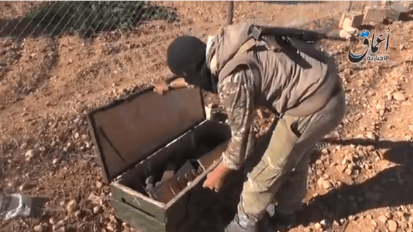 Video footage released on Tuesday showed ISIS militants displaying a parachute and wooden crates full of grenades and rockets.