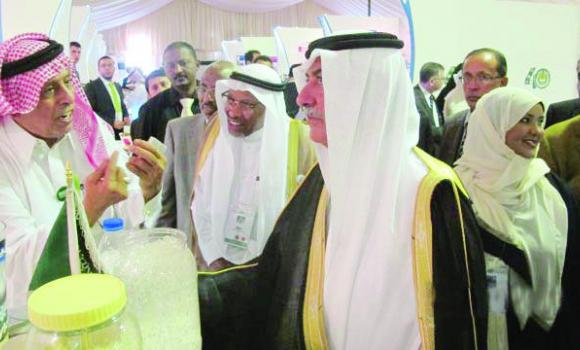Ibrahim M. Alalim, left, explains his inventions on fire-fighting on water technology during the 40th anniversary of the Islamic Development Bank (IDB) in Jeddah last June. At right is Finance Minister Ibrahim Al-Assaf and at center is IDB President Ahmad Mohamed Ali.