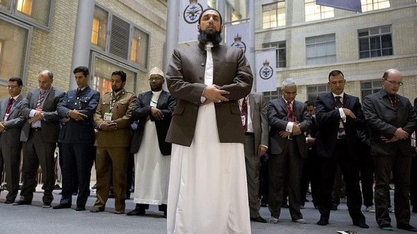 Imam Asim Hafiz, OBE the Islamic advisor to the Armed Forces leads the Prayers in the Ministry of Defense last July.