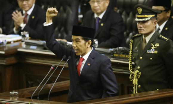 Indonesian President Joko Widodo raises his fist as he delivers his speech during his inauguration ceremony as the country's 7th president at the Parliament building in Jakarta on Monday.