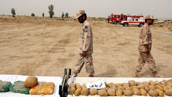 Iranian border guards display the packages of seized Afghan-made drugs at the Iran-Afghanistan border check point in Milak, south-eastern province of Sistan-Baluchestan, Iran, Oct.10, 2012.