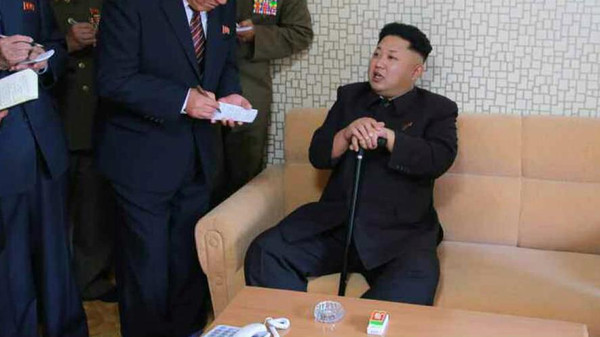 North Korean leader Kim Jong Un, using a cane for support, visited a housing development.