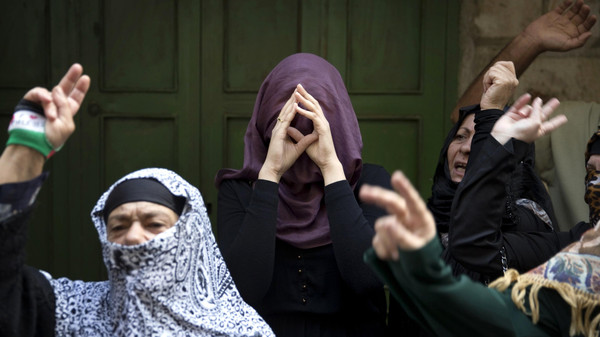 Palestinian women take part in a protest against Jewish visitors to the compound known to Muslims as Noble Sanctuary and to Jews as Temple Mount in Jerusalem's Old City October 14, 2014.