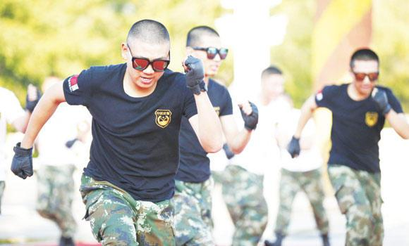 "Paramilitary soldiers dance to a song by the ""Chopsticks Brothers."""