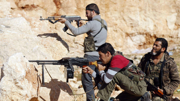 Rebel fighters take up positions on the frontline against forces of Syria's President Bashar al-Assad in the Handarat area, north of Aleppo Oct. 20, 2014.
