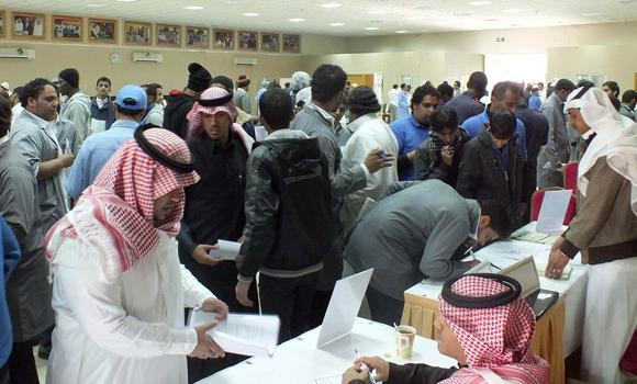 Saudis apply for jobs during a jobs fair held in Riyadh sometime last year.