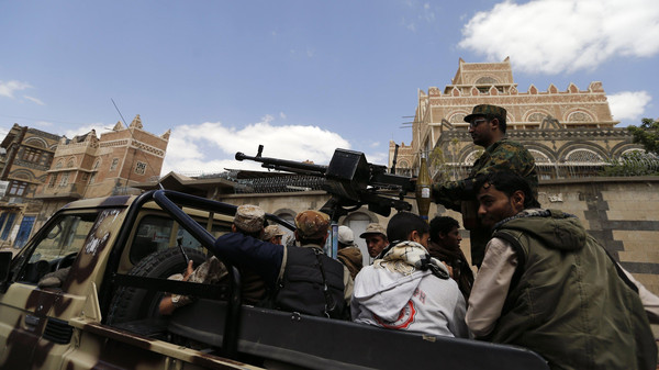 Shiite Houthi militants patrol the vicinity of a venue where a mass funeral for victims of a suicide attack on followers of the Shiite Houthi group was being held in Sanaa October 14, 2014.