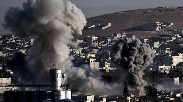 Smoke rises after strikes from the US-led coalition in the Syrian town of Ain al-Arab, known as Kobane by the Kurds, in the southeastern village of Mursitpinar, Sanliurfa province, on Oct. 10, 2014.