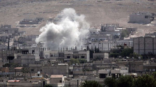 Smoke rises from the Syrian town of Kobane, seen from near the Mursitpinar border crossing on the Turkish-Syrian border in the southeastern town of Suruc, Sanliurfa province, on Oct. 3, 2014.