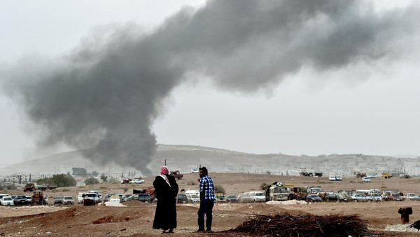 Smoke rises from the Syrian town of Kobane after a strike from the U.S.-led coalition as it seen from the Turkish-Syrian border in the southeastern village of Mursitpinar, Sanliurfa province, on October 14, 2014.