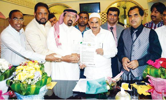 Telangana Deputy Chief Minister Mohammed Mahmood Ali holds the letter of commitment from prominent Saudi businessman Faiz Al-Abideen in Jeddah.
