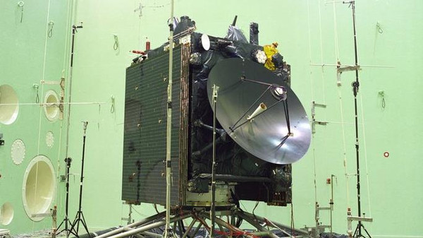 The Philae lander is attached to Rosetta's side.