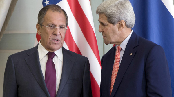 U.S. Secretary of State John Kerry (R) speaks with Russian Foreign Minister Sergei Lavrov during a meeting at the Chief of Mission Residence in Paris on Oct.r 14, 2014.