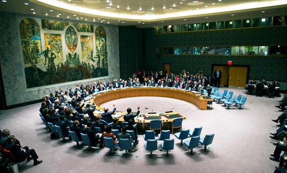 In this Sept. 27, 2013 file photo, the United Nations Security Council votes on a resolution that will require Syria to give up its chemical weapon, at U.N. Headquarters.