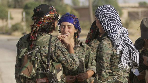 Women fighters of the Kurdistan Workers' Party on the front line in the Makhmur area near Mosul in Iraq on August 21 during the conflict with the ISIS.