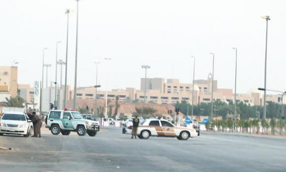 Riyadh police barricade the scene of shootout in which one US national was killed and another wounded in eastern Riyadh on Tuesday.
