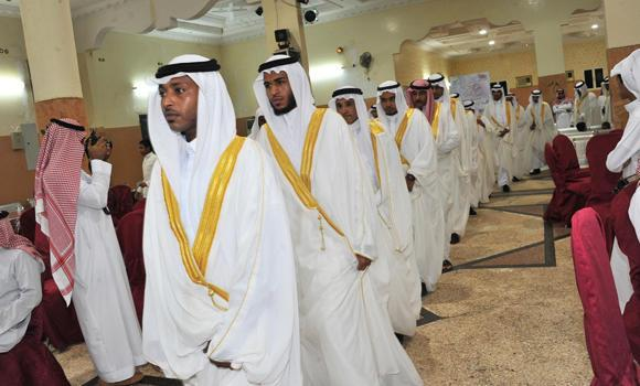 In this file photo, dozens of men are shown during a mass wedding sponsored by Al-Bir Charitable Society in Shuqaiq. At this time when marrying in the Kingdom has become too costly, mass weddings are seen as a logical way to avoid miser marriages. (SPA)