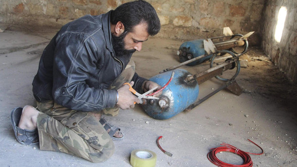 A Free Syrian Army fighter prepares a locally-made shell before firing it towards forces loyal to Syria's President Bashar al-Assad in Bani Zeid neighbourhood, Aleppo.