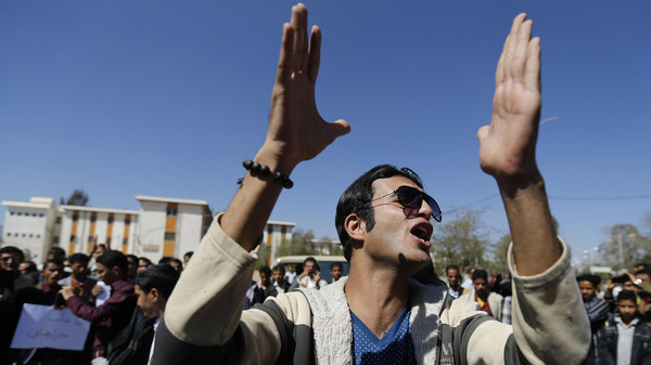 A student shouts slogans during a demonstration against the deployment of armed militia of the Shiite Houthi movement.