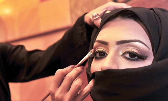 A woman has her makeup done. A beauty pageant was cancelled by authorities in Makkah after complaints from citizens.