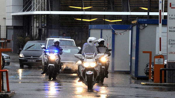 Police escort an ambulance believed to be carrying Algerian President Abdulaziz Bouteflika leaving the Grenoble Alembert clinic on Nov. 15, 2015.