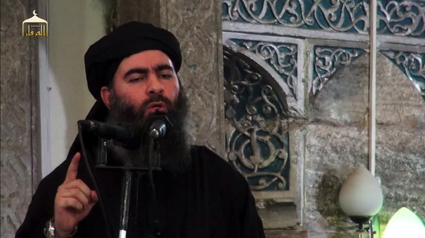Abu Bakr al-Baghdadi, pictured here in a mosque in July 2014 in Mosul, has reportedly been critically injured.