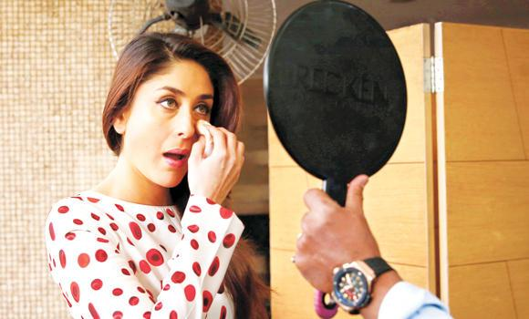 Actress Kareena Kapoor retouches her make up before a photocall in New Delhi, India.