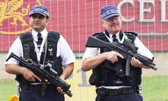 Armed police officers stand guard in Newport, south Wales, in this September 4, 2014 photo.