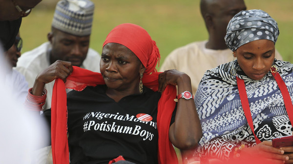 BringBackOurGirls campaigners attend a mourning session at the Unity fountain in Abuja, for victims of a suicide bomb attack in Potiskum, Nov. 14, 2014.
