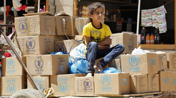 Cars carrying food and aid supplies entered a southern Damascus neighbourhood on Wednesday thanks to a local ceasefire agreement between pro-government officials and insurgents.