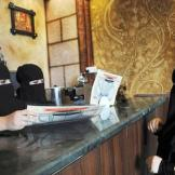 In this Nov. 30, 2013 file photo, veiled Saudi women work at a coffee shop in Tabuk, 1500 km from Riyadh.
