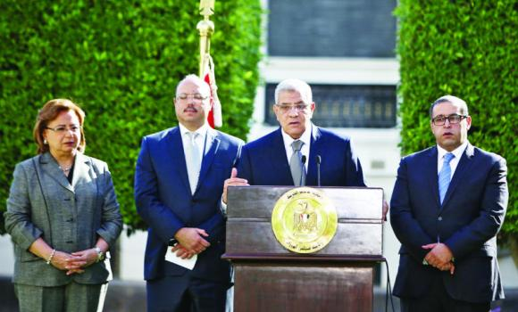 Egypt's Prime Minister Ibrahim Mahlab delivers a speech during a press conference in Cairo.