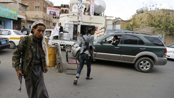 Followers of the Shi'ite Houthi group man a checkpoint on a street in Sanaa November 27, 2014.
