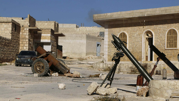Free Syrian Army fighters launch mortar shells towards forces loyal to Syria's President Bashar al-Assad in the Handarat area, north of Aleppo.