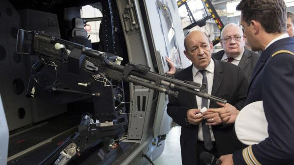 French Defence Minister Jean-Yves Le Drian inspects a weapons procurement agency last June.
