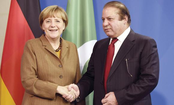 German Chancellor Angela Merkel shakes hands with PM Nawaz Sharif after their joint press conference in Berlin.