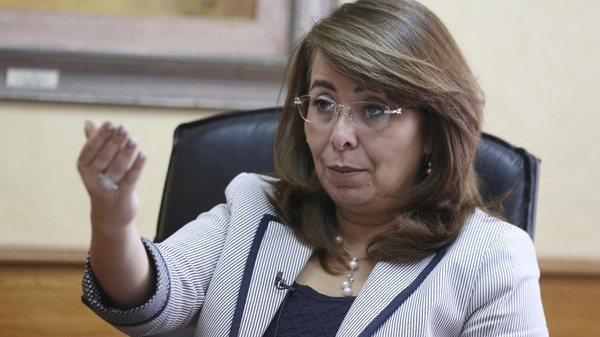 Egypt's Minister of Social Solidarity Ghada Wali talks during an interview with Reuters at her office in Cairo.