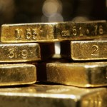 Gold slides below $1,150 as dollar strengthens