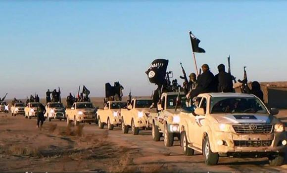 This file image posted on a militant website on Jan. 7, 2014, shows a convoy of vehicles and fighters from the Islamic State group in Iraq's Anbar Province. German intelligence were reported on Sunday as saying at least 550 jihadis from Germany were known to have fought in Iraq and Syria and about 60 have been died.