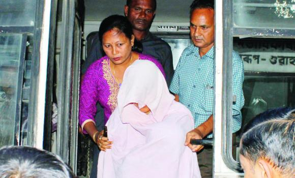 Indian security personnel escort a veiled woman, center, who is suspected of being involved in a plot to assassinate Bangladesh's Prime Minister Sheikh Hasina, to a court in the Indian city of Guwahati on Saturday.