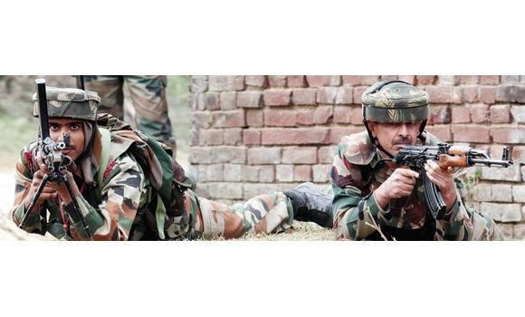 Indian soldiers take positions following an attack by militants at the Pindi Khattar belt of the Arnia border sector, some 45 km from Jammu district, on Thursday.