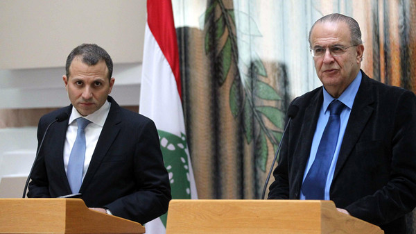 Cypriot Minister of Foreign Affairs Ioannis Kasoulides (R) and his Lebanse counteroart Gebran Bassil give a joint press conference in the capital Nicosia on Nov. 26, 2014.
