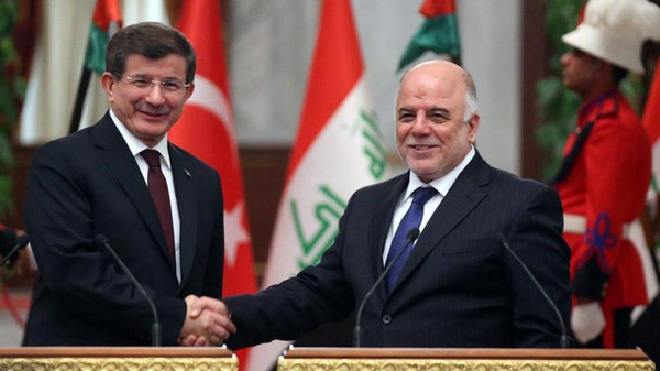 A handout picture made available by the Iraqi Prime Minister's Office on November 20, 2014 shows Iraq's Prime Minister Haidar al-Abadi (R) shaking hands with his Turkish counterpart Ahmet Davutoglu in Baghdad.