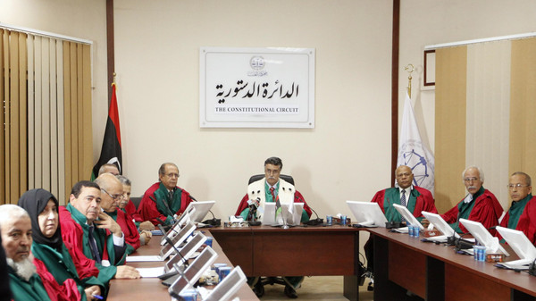 Judge Kamal Bashir Dahan (C), head of Libya's Supreme Court, meets with members of the Constitutional Chamber in Tripoli November 6, 2014.